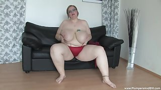 Chubby mature Gertruda in sexy red bra and panties, playing with her cunt