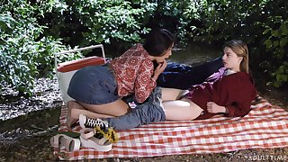 Picnic turns sapphic fuck together with these doting beauties are as a result pretty