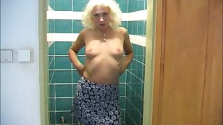 Natural auric head gets absolve be proper of her clothes and masturbates in the bathroom