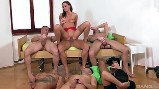 Tina Kay is the center of attention during awesome gangbang fuck