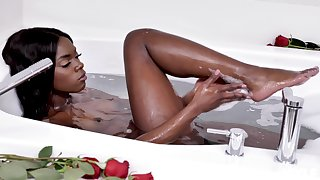 Ebony beauty showers her seemly pussy and clit